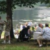 Family relaxing in picnic area overlooking lake