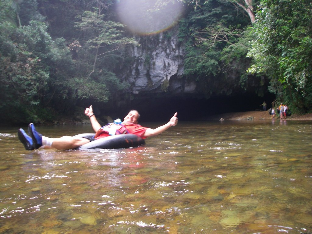 Guest enjoying himself on the Cave Tubing Tour | Image #7/10 | Belize Archaeology, Caves, Rainforest, Reef Tours