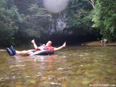 Guest enjoying himself on the Cave Tubing Tour - Daily/Customize tours (safe and affordable rates)