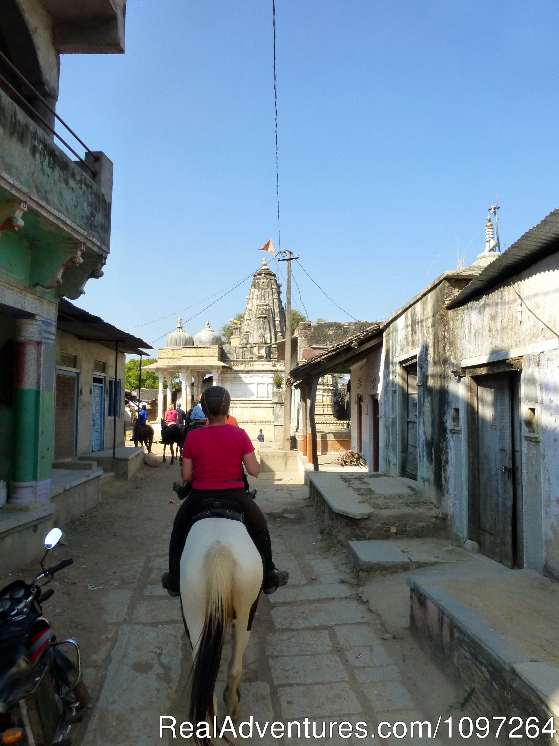 Riding through a village