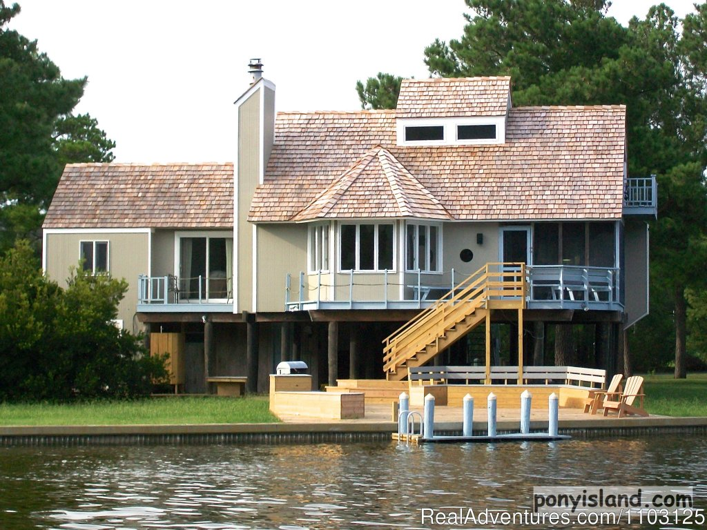 Fabulous 4 B.R. 4 Bath home in the tranquil private Oyster Bay Community. Crabbing and boating from your private dock. Enjoy Three Sun Decks; screened porch; Fantastic water-views; Fireplace and more. Google us at ponyisland  Email for correct quote!