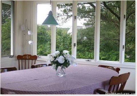 Dining room with pass-through to Kitchen | Image #4/13 | Spinnaker Chincoteague Waterfront Vacation House -