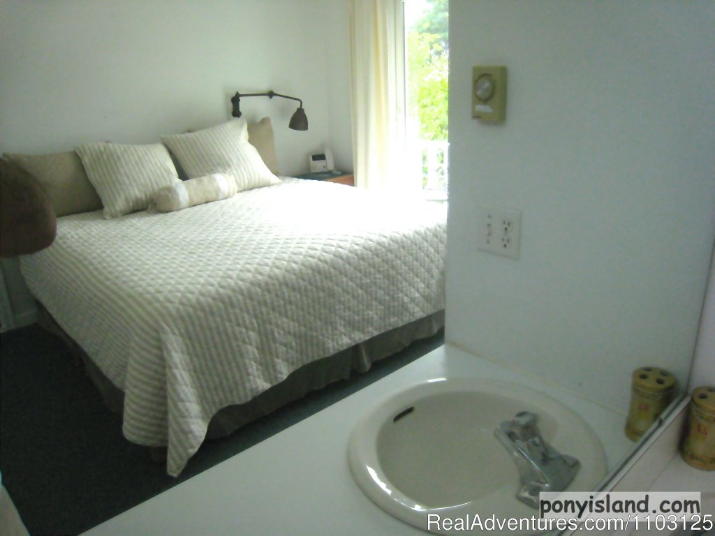 Master king bedroom with sink and vanity | Image #9/13 | Spinnaker Chincoteague Waterfront Vacation House -