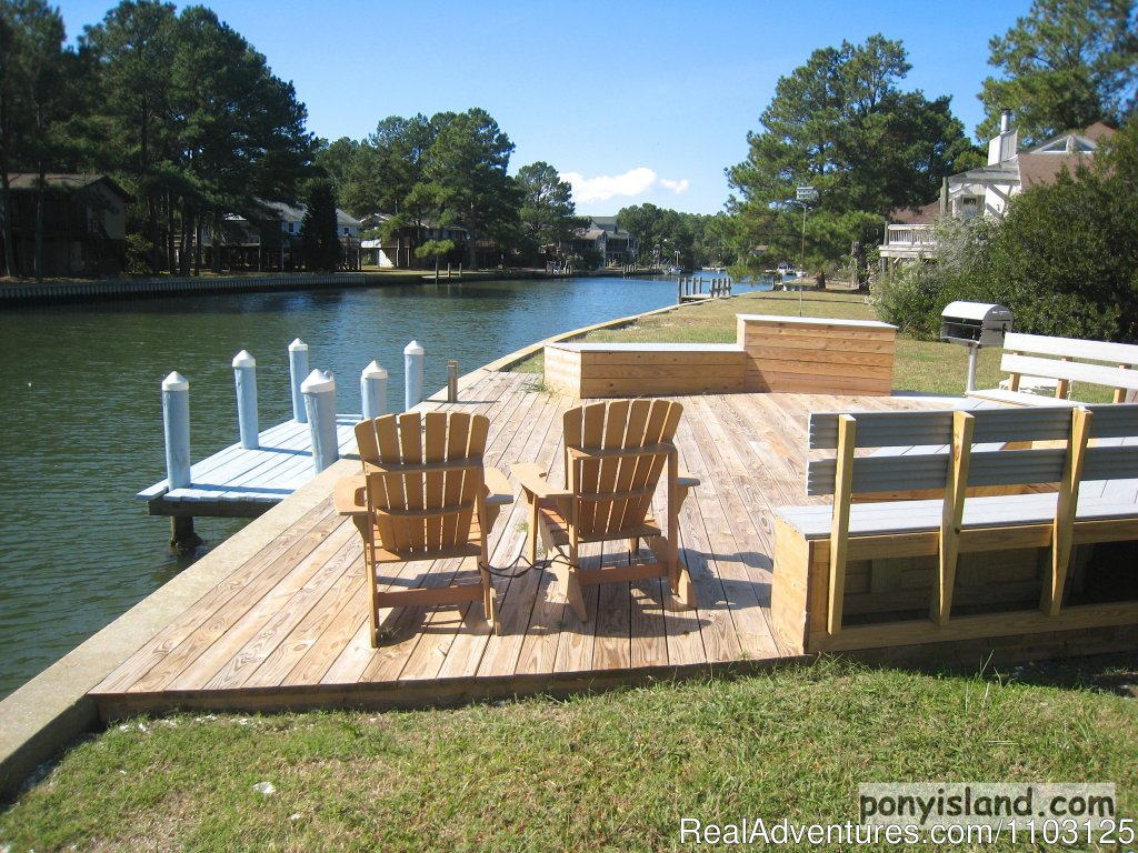 Private Boat Dock and Outdoor living area Great Crabbing | Image #3/13 | Spinnaker Chincoteague Waterfront Vacation House -