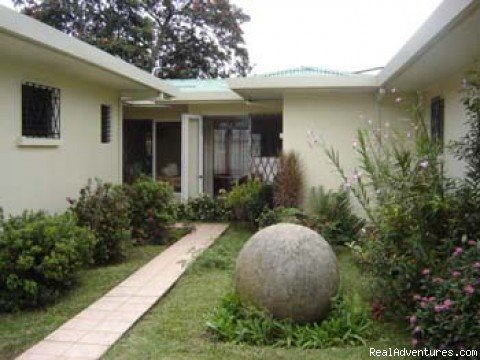 Garden with our own ancient sphere | Image #2/6 | Hostel Bekuo - Costa Rica's finest hostel