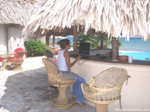Checking email at Tiki Bar - Romantic Almond Beach Belize