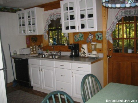 Three Bedroom Economy Cabin Kitchen | Image #5/16 | Resort Cabin Rentals near Beavers Bend State Park