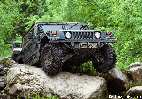 Drive the Hummer over big rocks - You Drive Adventures Hummer and ATV Rentals