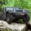 Drive the Hummer over big rocks