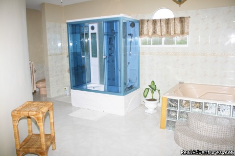Master bedroom Ensuite bathroom: Double Jacuzzi and shower - Ocho Rios OceanView Villa: Free night