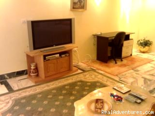 tv and workdesk - Luxury Self-Catering Studios in Tripoli Libya