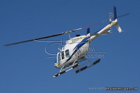 Helicopter Tours & Transfers in Belize. Bell 206 Long Ranger L4