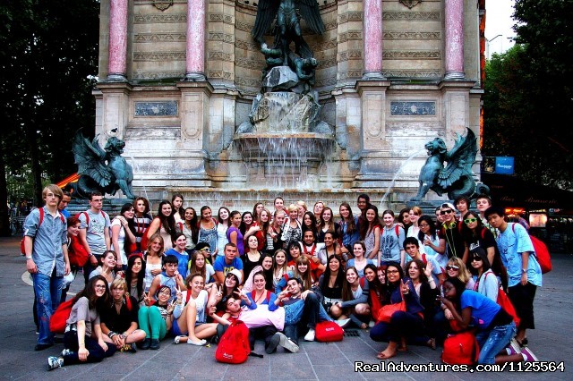 at the Saint Michel fountain in the Latin Quarter - French Summer courses in Paris for Juniors