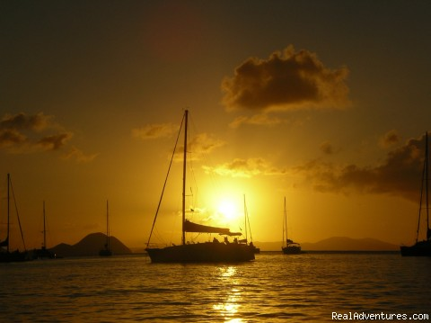 Family and Friends Dream Sailing Vacations Anchored at Norman Island BVI at Sunset