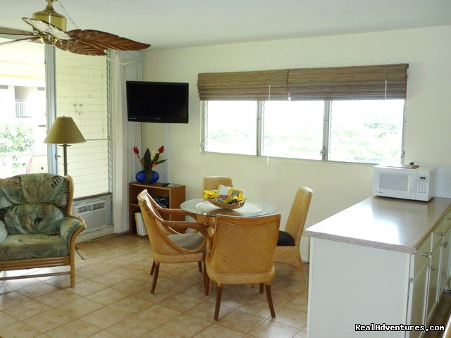 Dining area with windows to the sea. Great breezes!