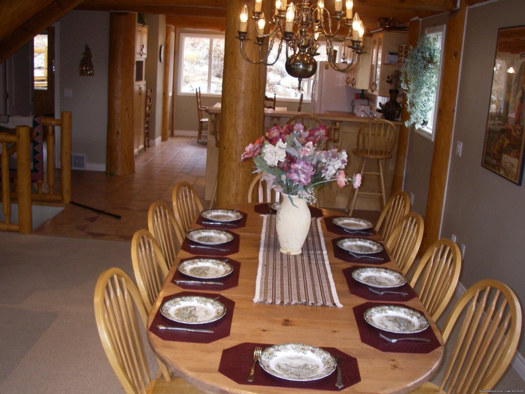 Formal dining area in great room boasting  spectacular views | Image #13/23 | Sun Peaks Resort Private Post &Beam Chalet
