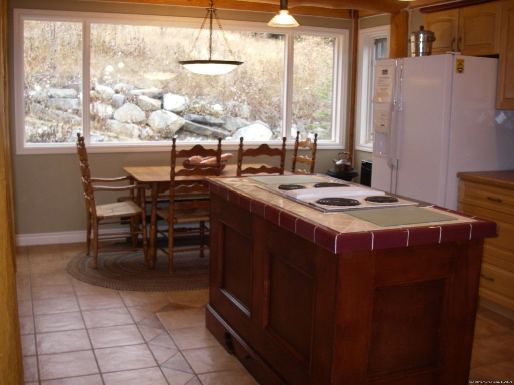 Breakfast table/kitchen area  | Image #10/23 | Sun Peaks Resort Private Post &Beam Chalet