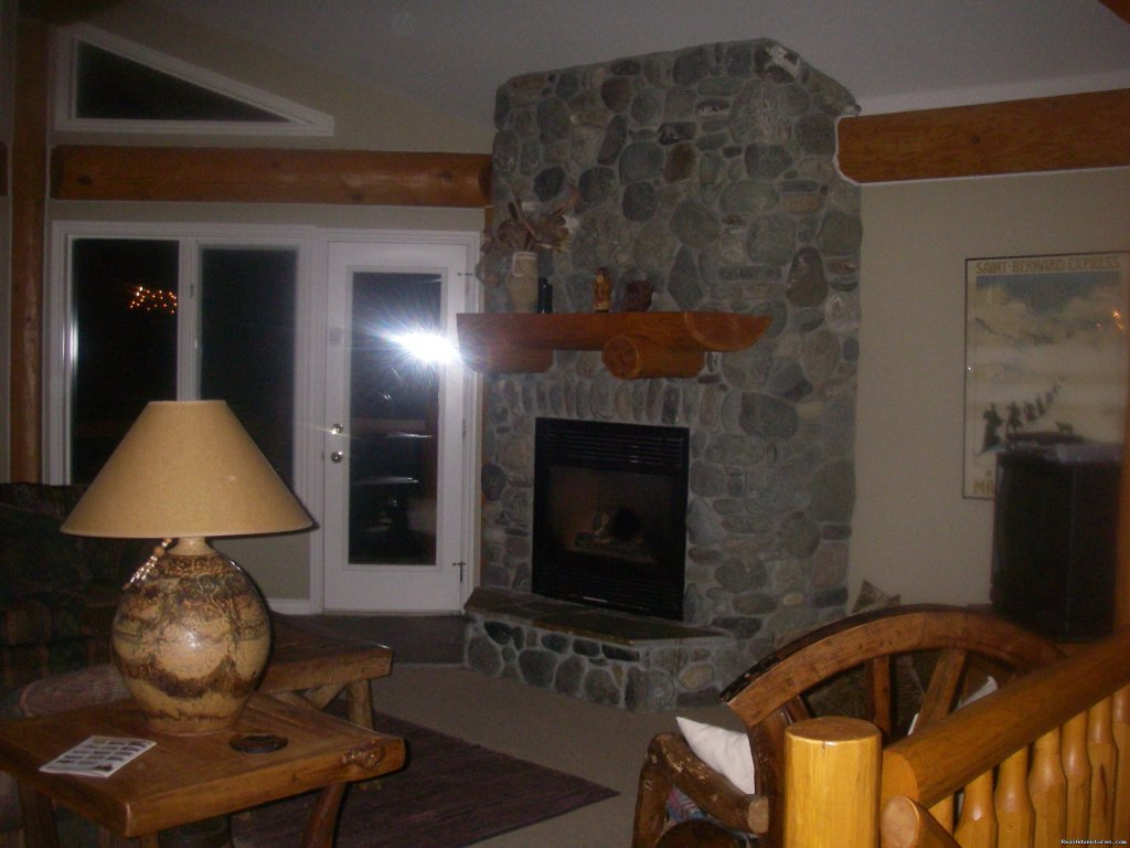 River rock fireplace. | Image #15/23 | Sun Peaks Resort Private Post &Beam Chalet