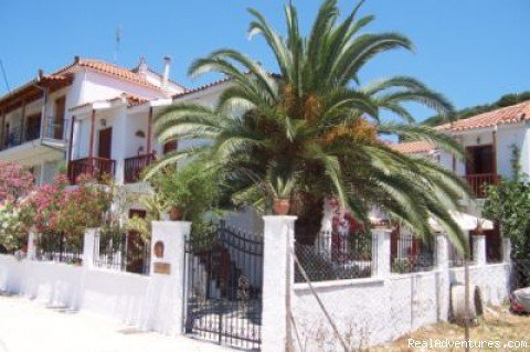 A small complex built in traditional style in the town of skiathos island greece
