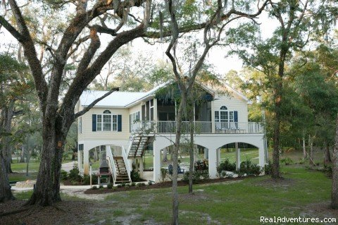 Three bedroom/3 bath cottage, loacted on the bank of the histortic Suwannee River, 40 miles west of Gainesville, Florida. Turnkey, just bring your groceries, and a change of clothes.
