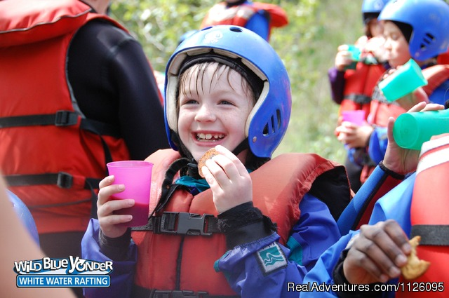 A wee river rat enjoying a cookie after the Smoky River - Alberta's Best Rafting at Wild Blue Yonder