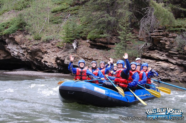 Waving to the camera on Sulphur River - Alberta's Best Rafting at Wild Blue Yonder