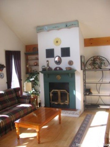 Living Room - Charming slopeside chalet with private lake access