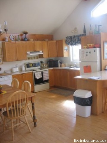 Fully equipped kitchen - Charming slopeside chalet with private lake access