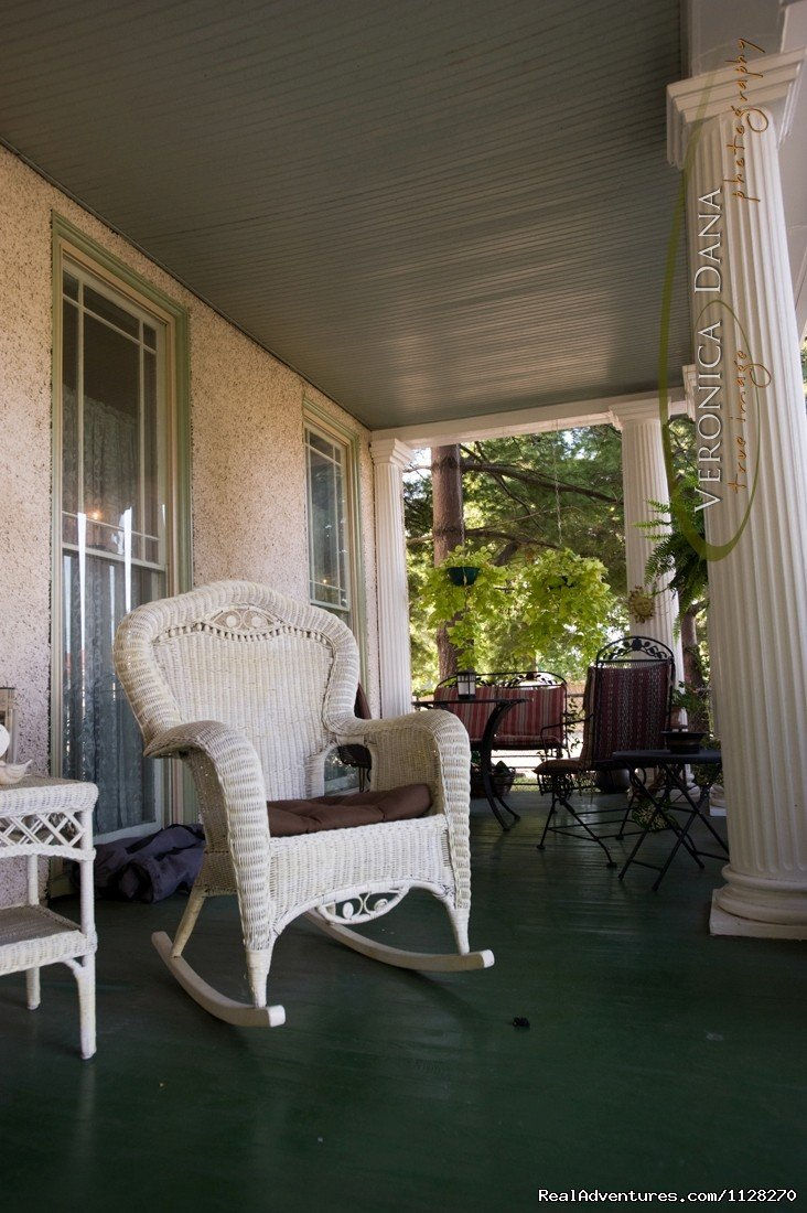 Relax on Wrap-Around Front Porch Under the Magnolias | Image #16/16 | A Jewel of Comfort & Hospitality - Magnolia House