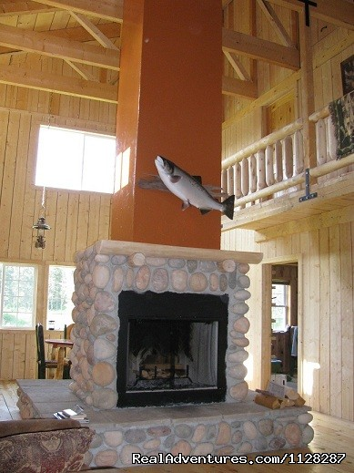 Relax in front of the fireplace after a hard day of fishing - Deshka Wilderness Lodge