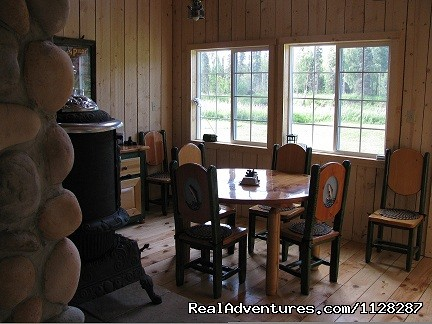 River front dining room with working pot belly stove - Deshka Wilderness Lodge