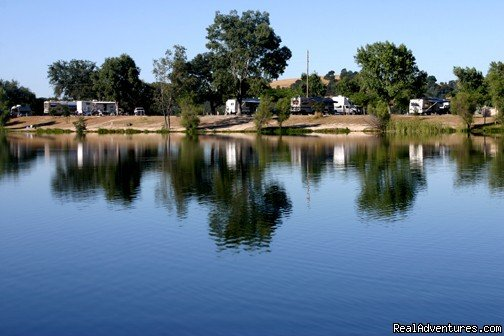 We are a destination resort in the Sierra foothills featuring RV sites, tent camping, motel units, and cottages. Wineries, restaurants, shopping, and a casino are all located nearby. Lake features a world-class bass fishery, plus trout and catfish.