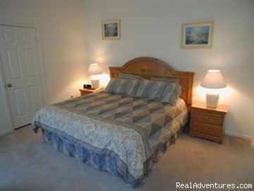 king sized en-suite bedroom - Luxury Pool Home Accommodation near Disney World