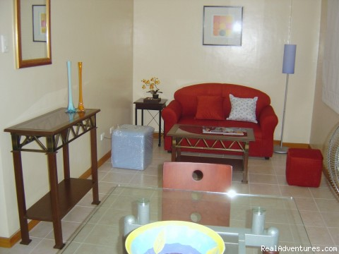 The Unit's Living Room - City Resort Residence right in Ortigas