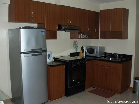 Fully-equipped kitchen - City Resort Residence right in Ortigas