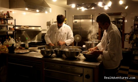 Preparing gourmet meals in the kitchen - Trout Point Lodge Relais & Chateaux Canada