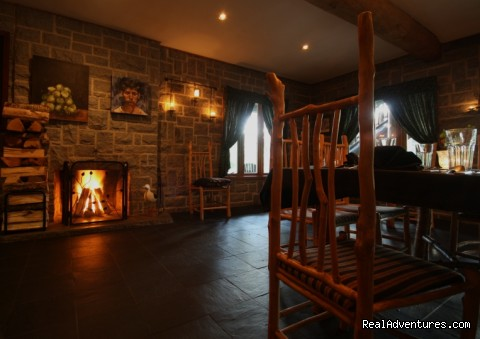 The Dining Room with wood-burning fireplace - Trout Point Lodge Relais & Chateaux Canada