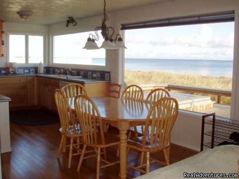 Dining and kitchen views overlooking Dungeness Bay - 3 Crabs Beach House - Private Beach & Hot Tub