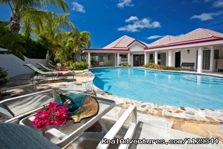 Pool area with Chaise Loungers - Life is Good at Coconut Grove Villa.