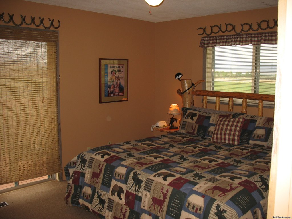 Master Bedroom in Kamloops with ensuite bath | Image #7/19 | Riverfront Cabins on a Private 1400 acre ranch