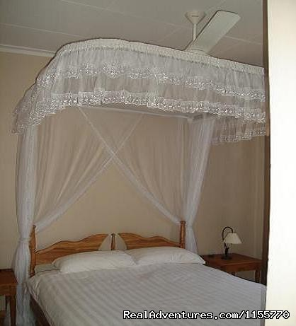 Bedroom - Milimani Self Catering Cottages