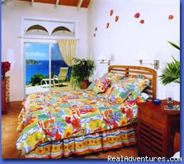 one of air-conditioned bedrooms overlooking the Caribbean