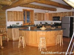 Large kitchen with island - Romance & Adventure at the Montana Beartooth Cabin