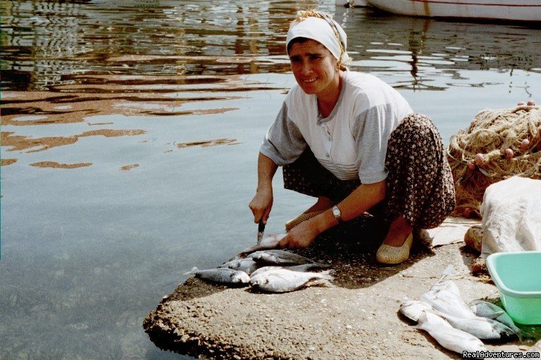 Our friend in Kekova, cleaning the fish | Image #13/22 | Sailing The Aegean Sea