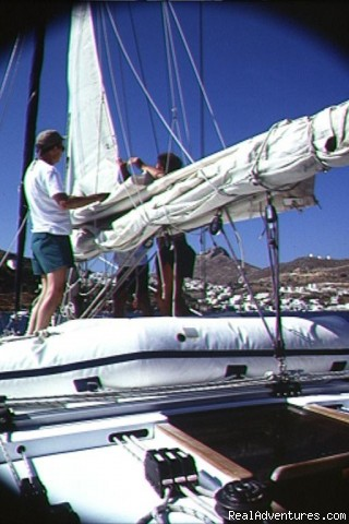 Raising the main - Sailing Charters Private or Share. Greece & Turkey