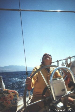 Taking the helm - Sailing Charters Private or Share. Greece & Turkey