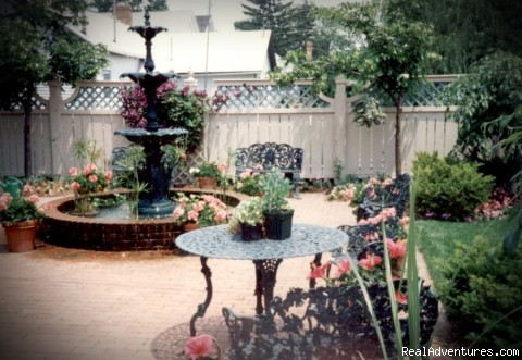 The beautiful English Garden w/3 tiered water fountain - The Housley House B&B is The Cream Of The Crop