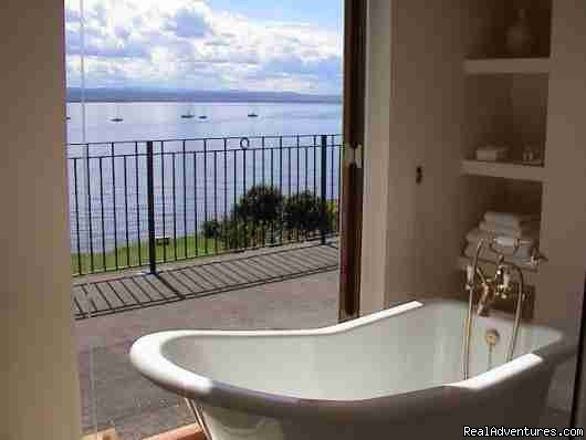 The bathroom in Bedroom 1 and French doors to terrace. | Image #2/8 | 5 star Water's Edge Bed and Breakfast in Scotland