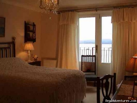 Bedroom 1 and French doors to terrace. - 5 star Water's Edge Bed and Breakfast in Scotland