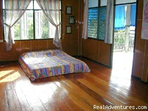 Spacious wood flooring guest room. - A Thai Village Home Stay for Cultural Experience.